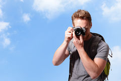 Young man taking photo Stock Images
