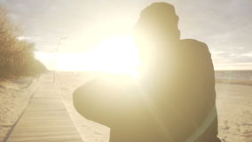 Young man taking photo at the beach. stock video footage