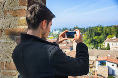 Young man taking photo with cell phone of the Stock Photos