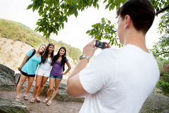 Young man taking photo of friends Royalty Free Stock Images