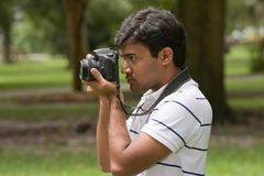 Young man taking photograph Royalty Free Stock Photo