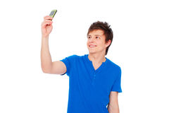 Young man taking picture on phone Royalty Free Stock Photography