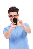 Young man taking a picture of you Royalty Free Stock Photos