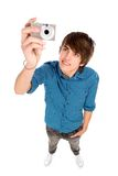 Young man taking pictures Royalty Free Stock Image