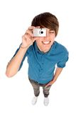 Young man taking pictures Stock Photography