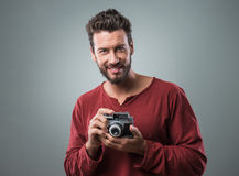 Young man taking pictures with a vintage camera Stock Photos