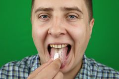 Young Man taking a pill royalty free stock image