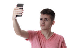 Young man taking self portrait with mobile phone Royalty Free Stock Image