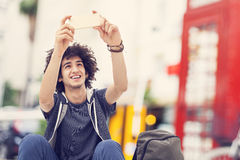 Young man taking self portrait Royalty Free Stock Photo