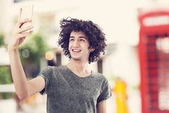 Young man taking self portrait Royalty Free Stock Images