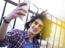 Young man taking selfie. Outdoors Royalty Free Stock Photo