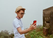 A young man taking selfie photo stock photo