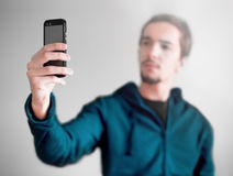 Young man taking a selfie photo. Isolated royalty free stock photo