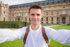 Young man taking a selfie photo outdoors in Paris. Happy young man taking selfie in Paris Royalty Free Stock Photography
