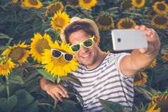 Selfie in sunflower field Royalty Free Stock Photos