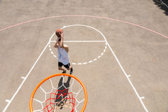 Young Man Taking Shot on Net on Basketball Court Royalty Free Stock Images