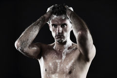 Young man taking shower Stock Images