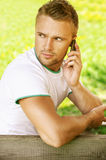 Young man talk on mobile phone Stock Image