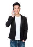 Young man talk to cellphone Stock Photo