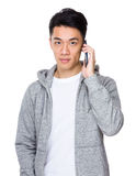 Young man talk to cellphone Royalty Free Stock Photo
