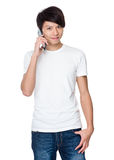 Young man talk to cellphone Royalty Free Stock Images