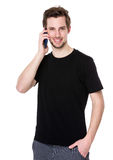 Young man talk to mobile phone royalty free stock photo