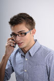 Young man talking. White, young, handsome man talking on mobile Royalty Free Stock Photos