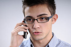 Young man talking. White, young, handsome man talking on mobile Royalty Free Stock Images
