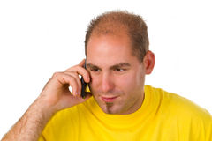 Young man talking on a cell phone Stock Image