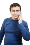 Young man talking on cell phone Stock Images