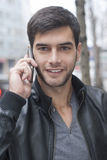 Young Man talking with cell phone Stock Images