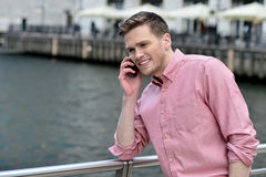 Young man talking on the cell phone Stock Photography