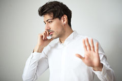 Young man talking on cell phone Stock Photos