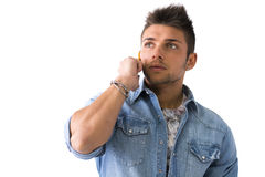 Young man talking on cell phone (mobile) Royalty Free Stock Photos