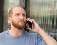 Young man talking on cell phone Royalty Free Stock Photo