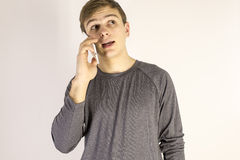 Young man talking on cell phone. On white background Royalty Free Stock Photo