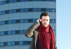 Young man talking on cellphone outdoors Royalty Free Stock Images