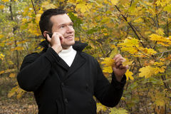 Young man talking on cellphone at park Royalty Free Stock Photo