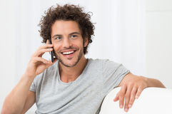 Young Man Talking On Cellphone Stock Photos
