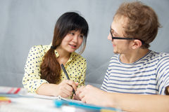 Young man talking with a Chinese girl Stock Photo