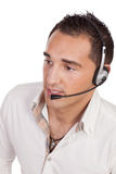Young man talking on headphones with microphone Royalty Free Stock Image