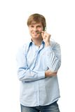 Young man talking on headset Stock Images