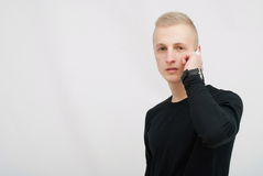 Young man talking on his mobile phone isolated on white background Royalty Free Stock Image