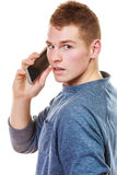 Young man talking on mobile cell phone Stock Photography