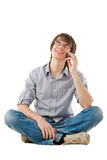 Young man talking by mobile phone Royalty Free Stock Photography