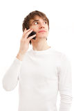 Young man talking by mobile phone Royalty Free Stock Photos