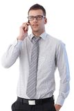 Young man talking on mobile phone. Young businessman talking on mobile phone Royalty Free Stock Image
