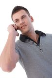 Young man talking on mobile phone. Portrait of young man talking on mobile phone Royalty Free Stock Photos