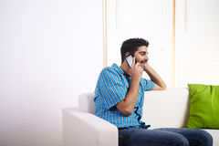 Young man talking on the mobile phone Stock Image