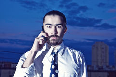 Young man talking on mobile phone. Portrait of a handsome young man talking on mobile phone Royalty Free Stock Images